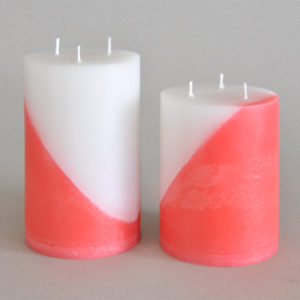 Two tone red and white candle pillar set