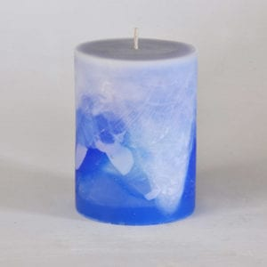 Blue and white pillar candle